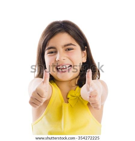 Studio portrait of a beautiful girl with thumbs up, isolated over white background - stock photo
