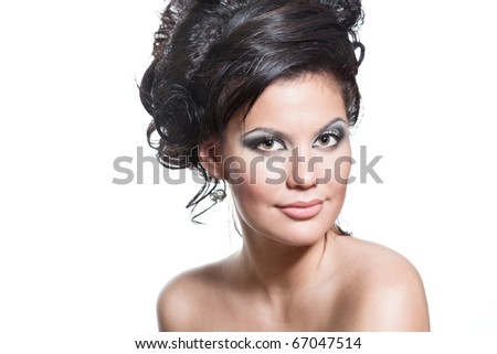 Studio portrait of a beautiful sexy brunette woman with perfect makeup and hair - stock photo