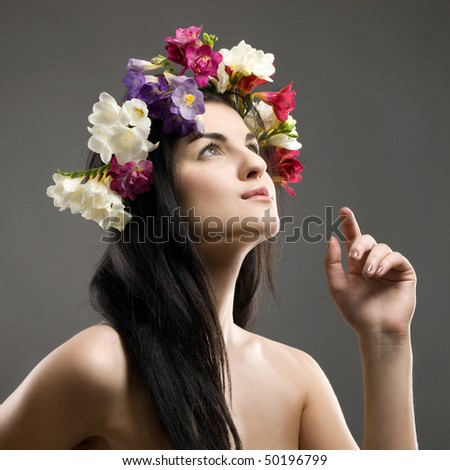 studio portrait of a beautiful with flower crown