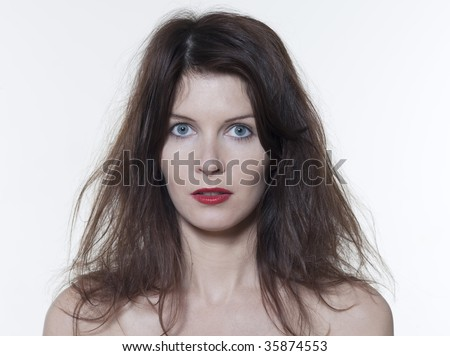 studio portrait of a beautiful woman on isolated on white background hair mess - stock photo
