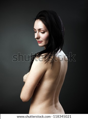 Studio portrait of a beautiful woman's back