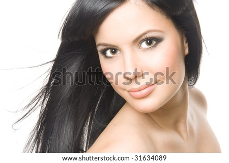 Studio portrait of a beautiful young brunette woman - stock photo