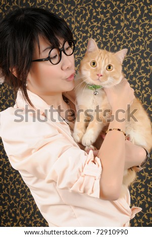 studio portrait of a beautiful young hold a cat - stock photo