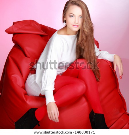 Studio portrait of a beautiful young woman with long healthy hair in casual wear on Beauty and Fashion