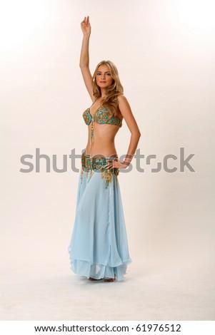 Studio portrait of a belly dancer - stock photo