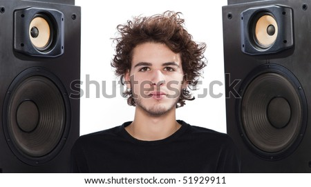 studio portrait of a caucasian young man listening to music on white backgroun - stock photo