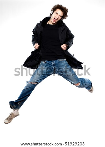 studio portrait of a caucasian young man listening to music on white background - stock photo