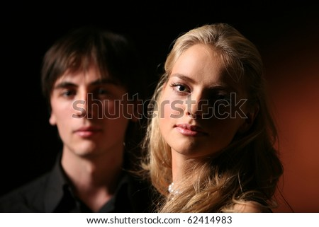 Studio portrait of a couple - stock photo
