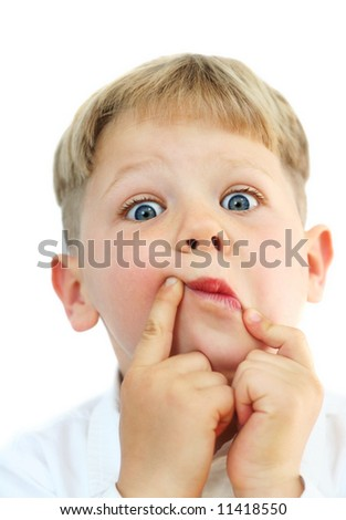 Studio portrait of a cute five year old boy making funny faces on white background - stock photo