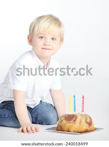 Studio portrait of a cute, pretty boy having birthday - stock photo