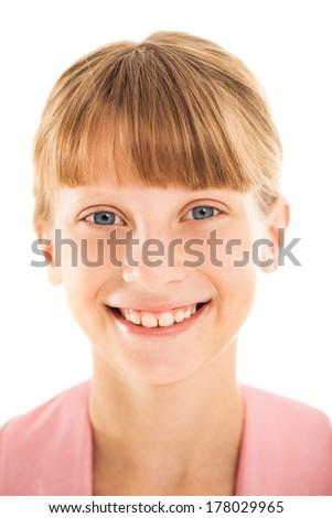 Studio portrait of a cute smiling girl. - stock photo