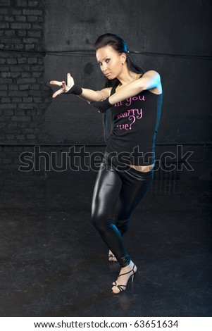 Studio portrait of a fashionable girl in a hand made shirt - stock photo