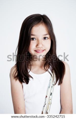Studio portrait of a girl on a light background - stock photo