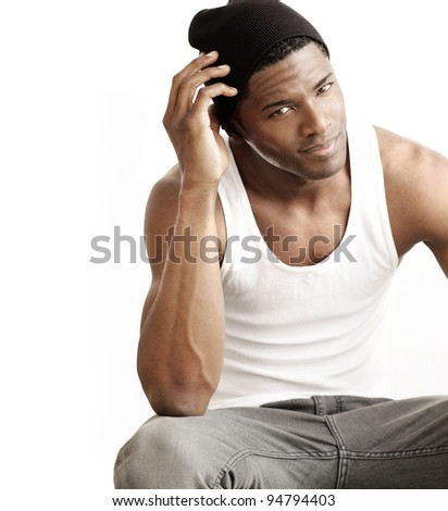 Studio portrait of a good looking young black man against neutral background with copy space - stock photo
