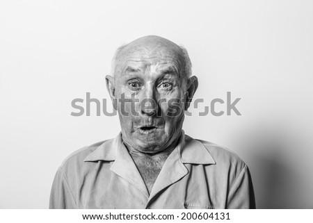 Studio portrait of a grandfather teasing - stock photo