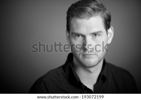 Studio Portrait of a handsome man looking to the camera