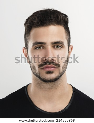 Studio portrait of a handsome young man astonished with something - stock photo