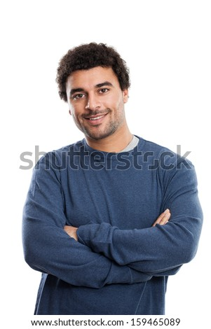 Studio portrait of a handsome young middle eastern man with arms folded in his twenties isolated on white background - stock photo