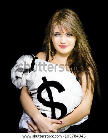 Studio portrait of a happy business woman holding a bag of American dollar bills, in a business success conceptual isolated on black background - stock photo