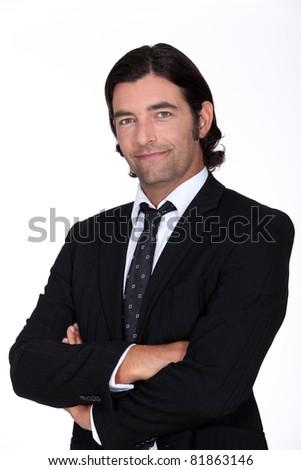 Studio portrait of a man in a suit - stock photo