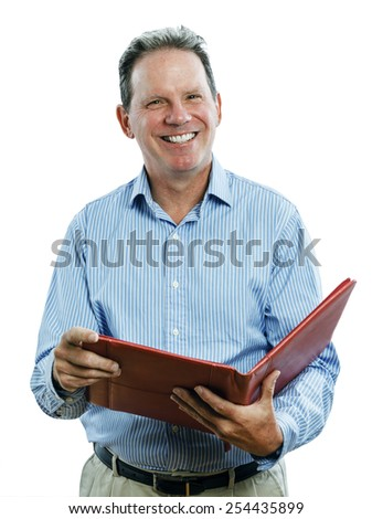 Studio portrait of a middle aged man holding a leather file folder open and smiling at the camera. - stock photo