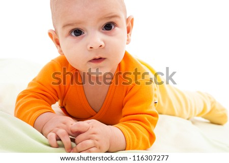Studio portrait of a newborn caucasian boy sitting on his tummy
