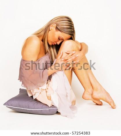Studio portrait of a relaxing beautiful young woman - stock photo