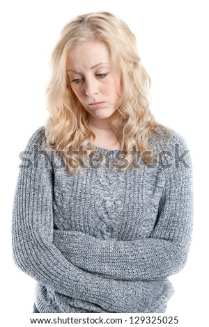 Studio portrait of a sad woman looking thoughtful about troubles - stock photo