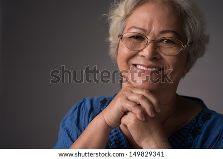 Studio portrait of a senior woman - stock photo