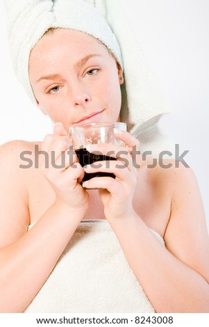 Studio portrait of a spa girl drinking coffee and waking up