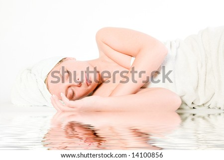 Studio portrait of a spa girl sleeping by the pool