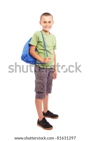 Studio portrait of a sporty child with backpack isolated on white background