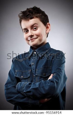 Studio portrait of a stylish cool boy - stock photo