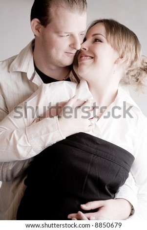 Studio portrait of a young amorous couple holding hands - stock photo