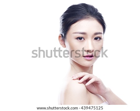 studio portrait of a young asian woman, isolated on white. - stock photo