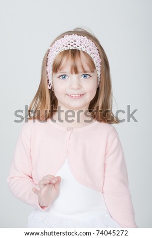 studio portrait of a young beautiful smiling girl - stock photo
