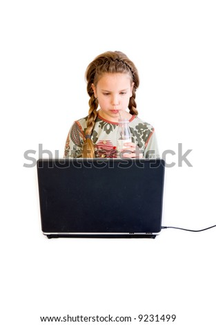 studio portrait of a young blond child with a notebook drinking a soda - stock photo