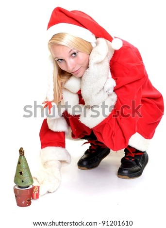 studio portrait of a young blonde woman dressed as Santa