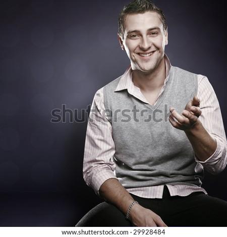 Studio portrait of a young confident man - stock photo