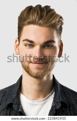 Studio portrait of a young fashion man  - stock photo