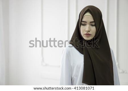 studio portrait of a young girl with a European face in eastern clothes on a white background - stock photo