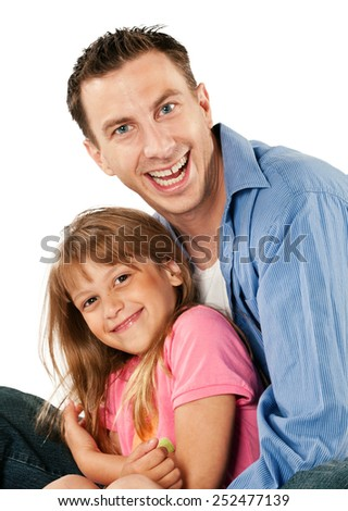 Studio portrait of a young girl with her step dad.