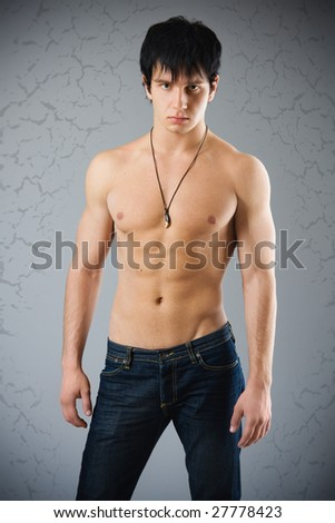 Studio portrait of a young handsome muscular man