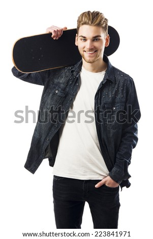 Studio portrait of a young man posing with a skateboard - stock photo