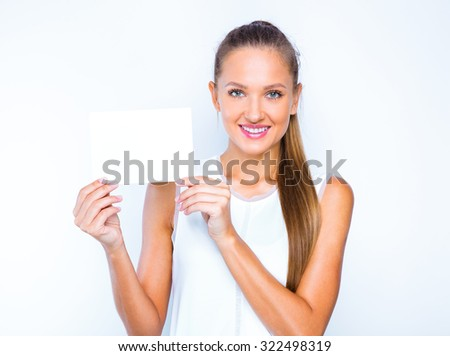 studio portrait of a young pretty girl holding blank board. isolated on white. - stock photo