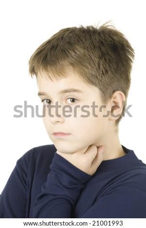 studio portrait of a young sad boy - stock photo