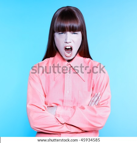studio portrait of a young screaming woman on isolated background - stock photo