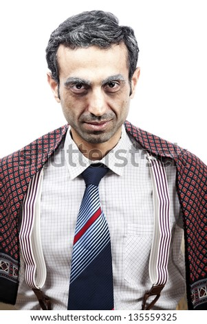 Studio portrait of an adult man (mid 30's) wearing old-man clothes and makeup, and giving an alluring look full with sexual intentions to the camera. Creepy. - stock photo
