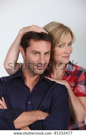 Studio portrait of an affectionate couple in their thirties - stock photo