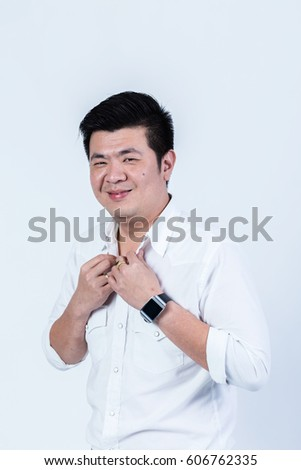 studio portrait of an asian businessman.